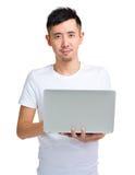 Asian man using laptop computer Stock Image