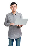 Asian man using laptop computer Royalty Free Stock Image