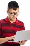 Asian man using laptop Royalty Free Stock Photos