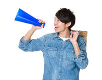 Asian man using megaphone for announcement about the shopping. Discount isolated on white background Stock Photos