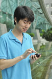 Asian man using mobile phone Stock Images