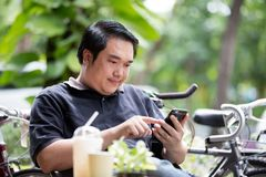 Asian man using on a mobile phone Stock Image