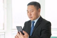 Asian man using smartphone Royalty Free Stock Photos