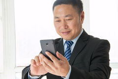 Asian man using smartphone Royalty Free Stock Images