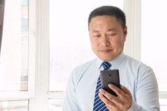 Asian man using smartphone Stock Photography