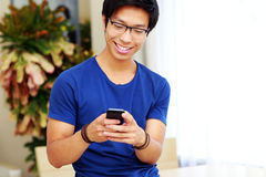 Asian man using smartphone Stock Photos