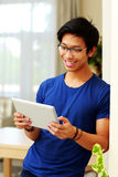 Asian man using tablet computer Royalty Free Stock Photos