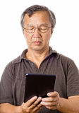 Asian man using tablet. Isolated on white background Royalty Free Stock Photography