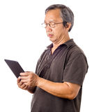 Asian man using tablet. Isolated on white background Royalty Free Stock Images