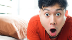 Asian man wake up surprisingly. royalty free stock images