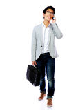 Asian man walking with laptop bag Stock Photos