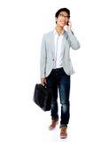 Asian man walking with laptop bag Stock Photos