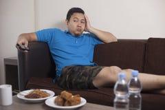 Asian Man Watch Tv stock photos