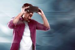 Asian man watching something on virtual reality headset Stock Images