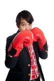 Asian man wear boxing gloves keep his guard up Royalty Free Stock Photos