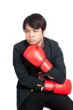 Asian man wear boxing gloves thinking of something Royalty Free Stock Image