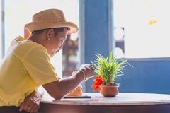 An Asian man wear hat and eat ice cream coconut in the resturent stock image