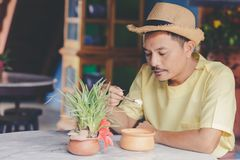 An Asian man wear hat and eat ice cream coconut in the resturent royalty free stock photos