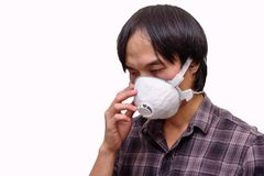 A asian man wear Hygienic mask. For protect PM2.5 Dust on White background royalty free stock image