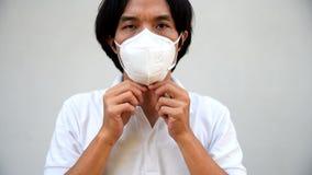 A asian man wear N95 mask