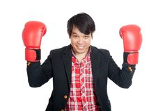 Asian man wear suit show boxing gloves Stock Photos