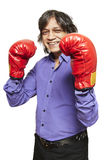 Asian man wearing boxing gloves smiling. On white background Royalty Free Stock Photo