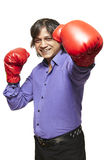 Asian man wearing boxing gloves smiling. On white background Royalty Free Stock Images