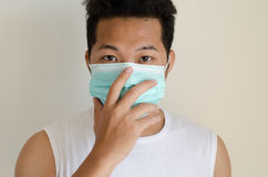 Asian man wearing a face mask Stock Images