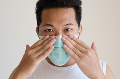 Asian man wearing a face mask Royalty Free Stock Photography