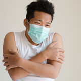 Asian man wearing a face mask Stock Photography