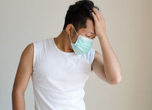 Asian man wearing a face mask Stock Photo