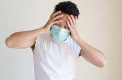 Asian man wearing a face mask Royalty Free Stock Images
