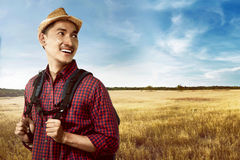 Asian man wearing hat travel alone. Image of handsome asian man wearing hat travel alone on the savanna stock photography