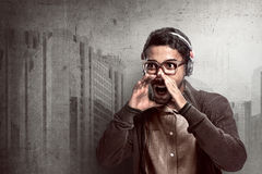 Asian man wearing headphone and shouting Stock Photos