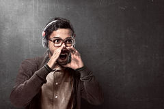 Asian man wearing headphone and shouting Stock Photography