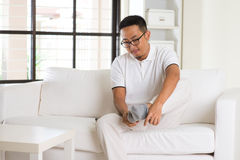 Asian man wearing socks Stock Image