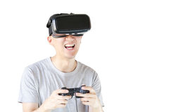 Asian man wearing VR goggle and immersing himself in VR multimedia Stock Photos