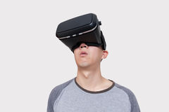 Asian man wearing VR goggle and immersing himself in VR multimedia Royalty Free Stock Photography