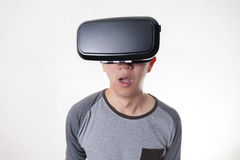 Asian man wearing VR goggle and immersing himself in VR multimedia Royalty Free Stock Images