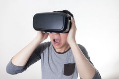 Asian man wearing VR goggle and immersing himself in VR multimedia Royalty Free Stock Photo