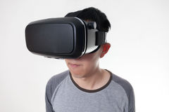 Asian man wearing VR goggle and immersing himself in VR multimedia Stock Photo