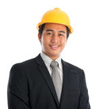Asian man wearing yellow hardhat. Royalty Free Stock Image