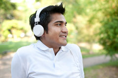 Asian Man with white headphones Royalty Free Stock Images