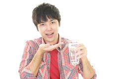 Asian man who drinks medicine. Asian man who drinks supplements Stock Photography