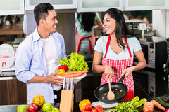 Asian man and woman cooking together royalty free stock image
