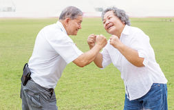 Asian man and woman figthing action and smile Royalty Free Stock Image
