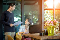 Asian man and woman freelance working at home office. Asian men and women freelance working at home office royalty free stock photos