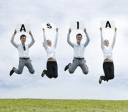 Asian man & woman jumping holding with a sign Royalty Free Stock Images