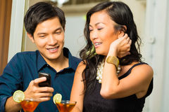 Asian man and woman in restaurant Stock Photos