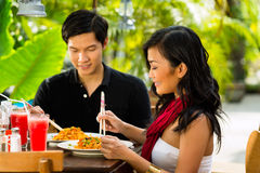 Asian man and woman in restaurant Royalty Free Stock Photos